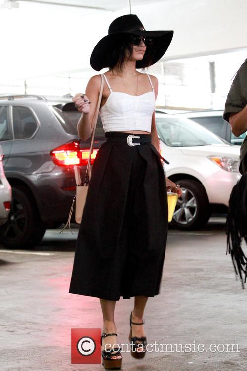 Vanessa Hudgens picks up lunch to go from...