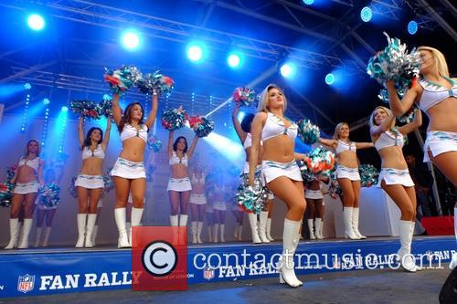 The Miami Dolphins Cheerleaders perform at the NFL...
