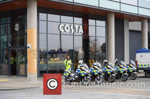 David Cameron and Police Escort Waits For The Prime Minister Media City 2