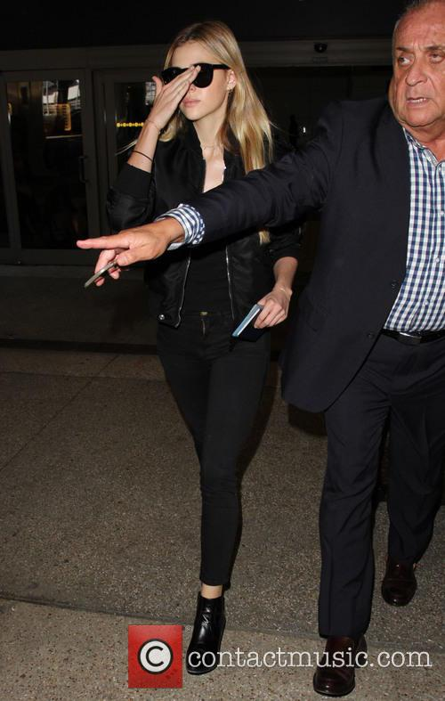 Nicola Peltz arrives at Los Angeles International (LAX)...