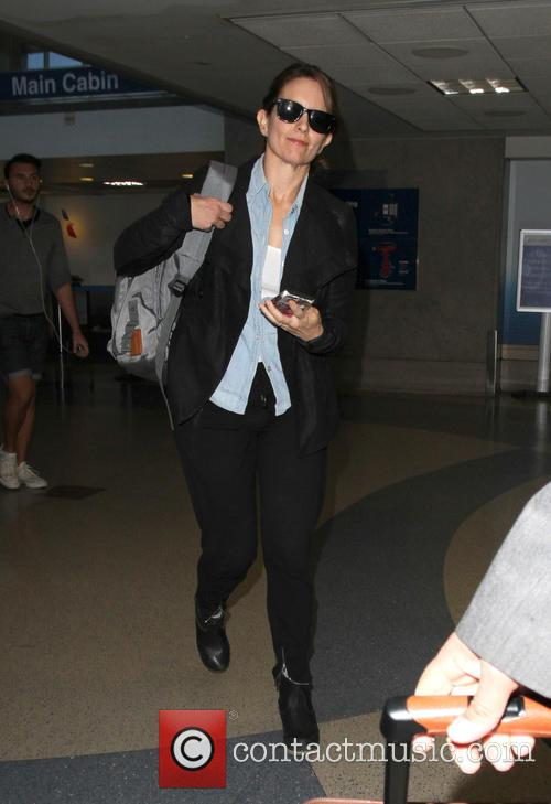 Tina Fey arrives at Los Angeles International Airport...