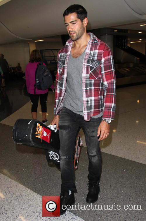Jesse Metcalfe arrives at Los Angeles International (LAX)...