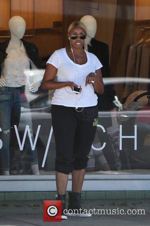 Nene Leakes chats on her phone while out...