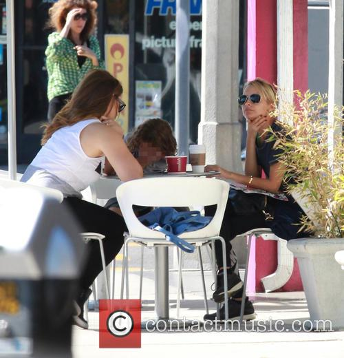 Nicole Richie helps her daughter Harlow with her...
