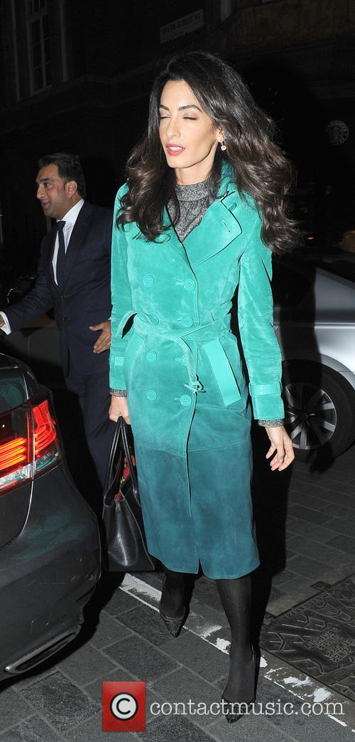 Amal Clooney leaves the Frontline Club and arrives...