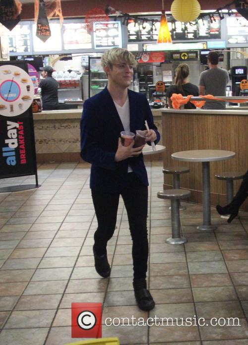 One of the Jedward twins picks up smoothies...