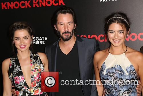 Ana De Armas, Keanu Reeves and Lorenza Izzo 6