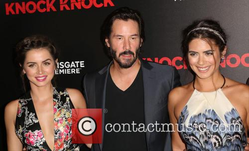 Ana De Armas, Keanu Reeves and Lorenza Izzo 9