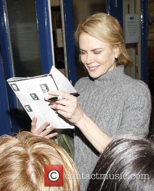 Nicole Kidman signs autographs for fans waiting outside...