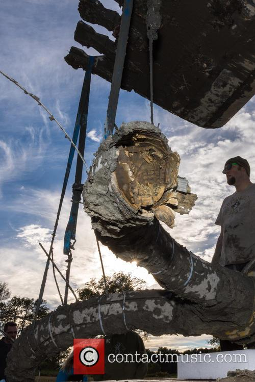 -m Earth, Environmental Sciences Undergraduate Student David Vander Weele Watches As The Mammoth Tusks and Skull Are Secured On A Flatbed Trailer. 1