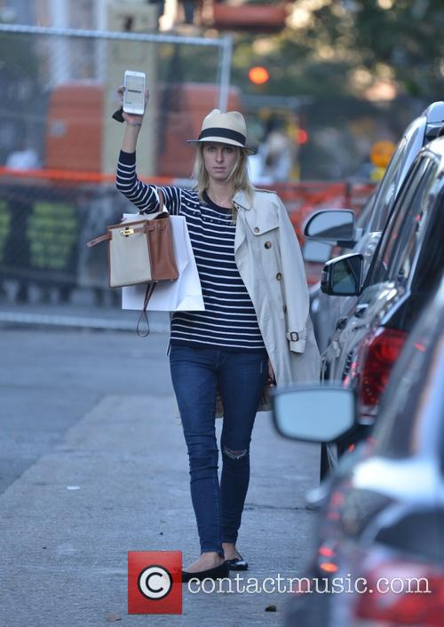 Make-up free Nicky Hilton hails a cab in...