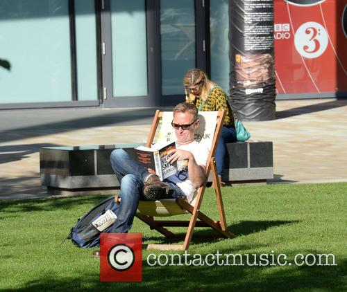 People Sat In The Sun At Media City 2