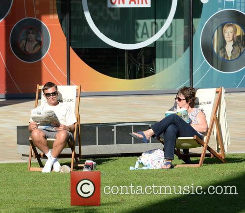People Sat In The Sun At Media City 3