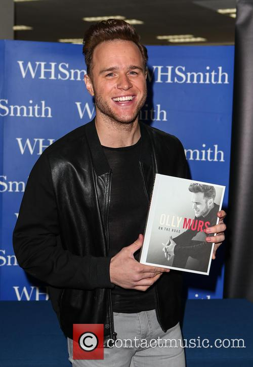 Olly Murs signs copies of his new book...