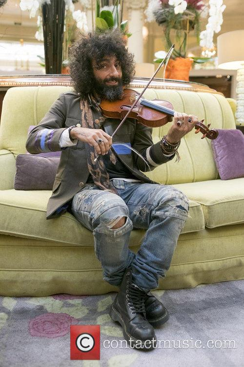 Lebanese violinist Ara Malikian performs for the press...