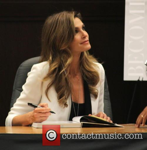 Cindy Crawford signs copies of her new book...