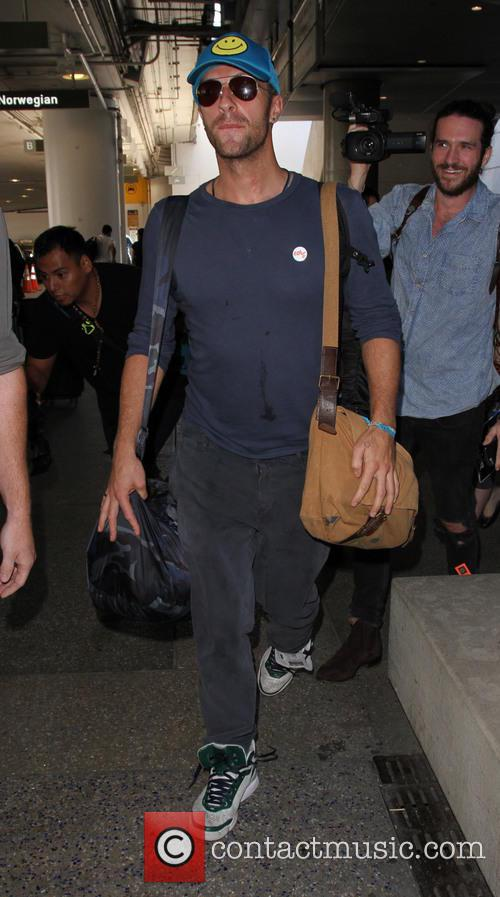 Chris Martin arrives from a flight at Los...