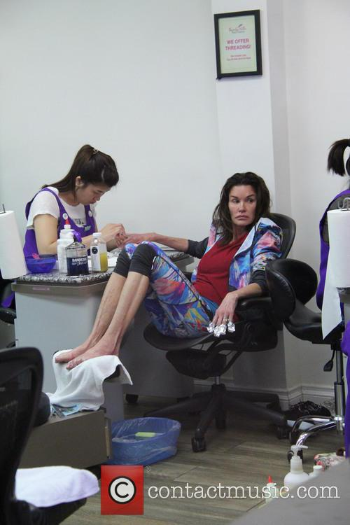 Make-up free Janice Dickinson gets a manicure and...