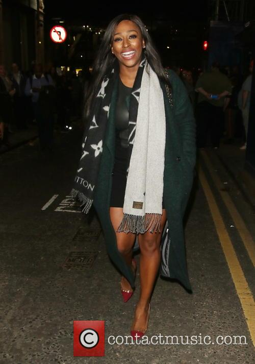 Alexandra Burke flashes her toned legs at the...
