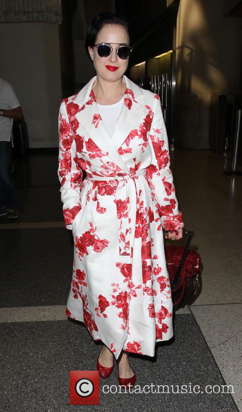 Dita Von Teese arrives on a flight to...