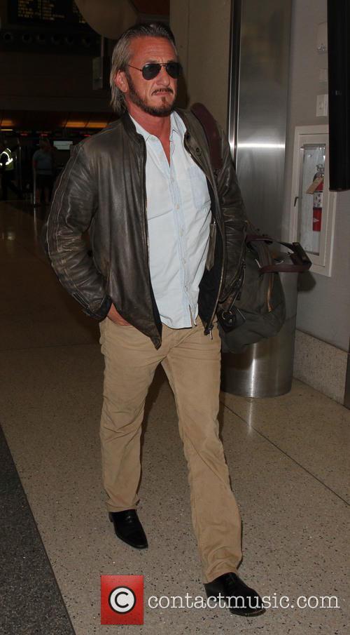 Sean Penn departs on a flight from Los...