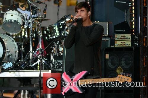 5 Seconds of Summer performing live on stage...