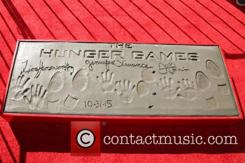 Josh Hutcherson, Jennifer Lawrence and Liam Hemsworth Hunger Games Handprints Footprints 2