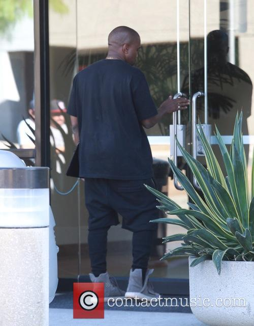Kanye West arriving to a studio in Agoura...