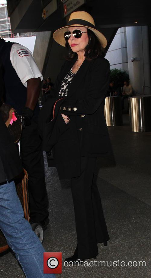 Joan Collins arrives on a flight to Los...
