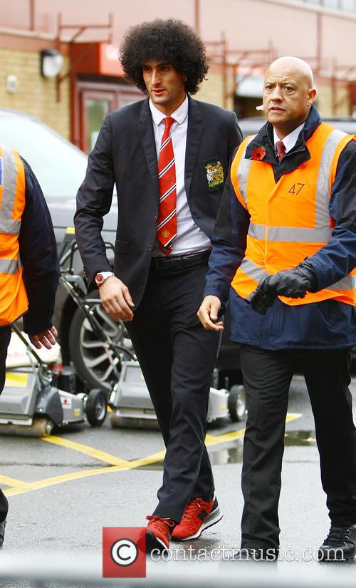 Marouane Fellaini arrives at Old Trafford alone