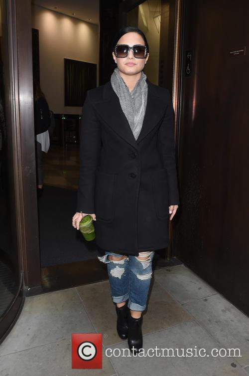Demi Lovato leaves an office building with a...