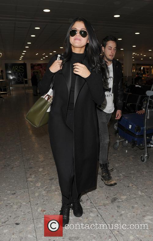 Selena Gomez lands at Heathrow Airport on a...