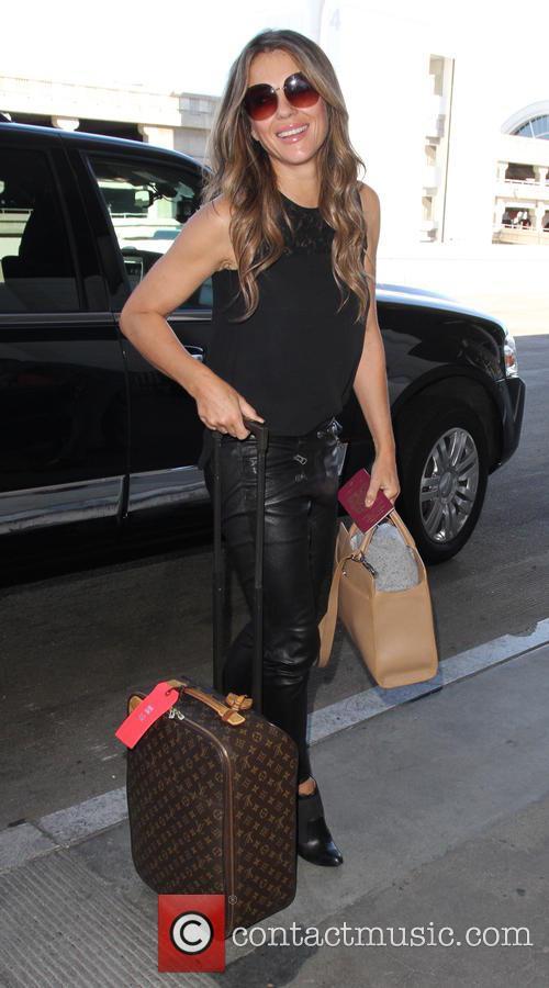 Elizabeth Hurley departs on a flight from Los...
