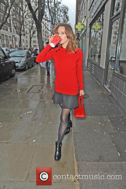 Kim Frickleton leaving Starbucks in Chelsea