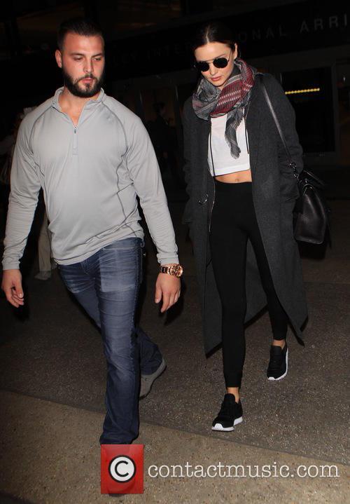 Miranda Kerr departs on a flight from Los...