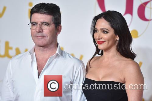 Lauren Silverman and  simon Cowell 6