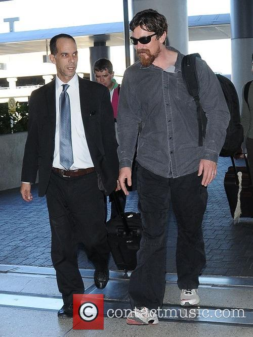 Christian Bale arrives at Los Angeles International (LAX)...