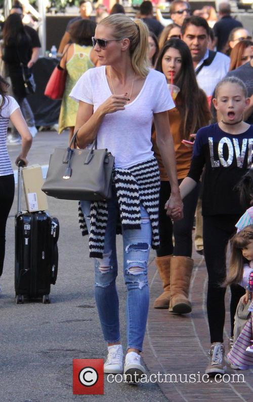 Heidi Klum shops with her children at The...