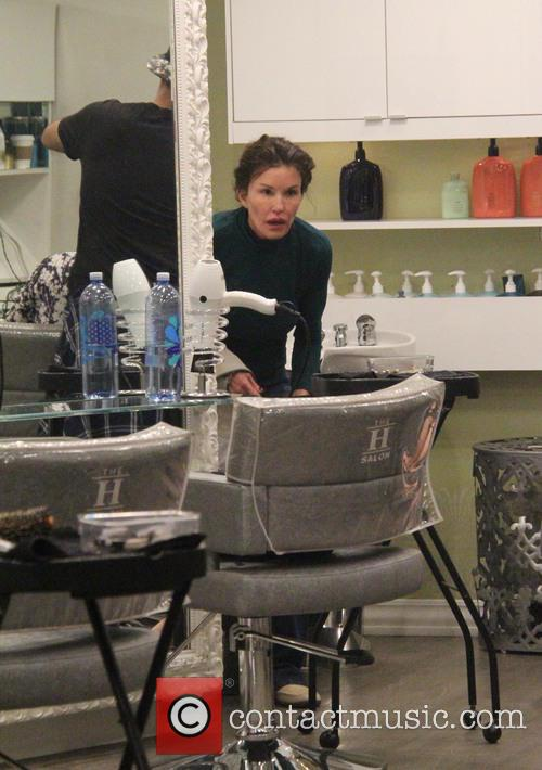 Janice Dickinson visits a hair salon with her...