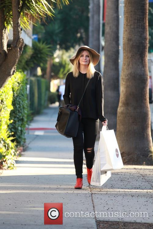 Mischa Barton carrying a Mou shopping bag