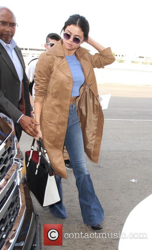 Selena Gomez departs on a flight from Los...