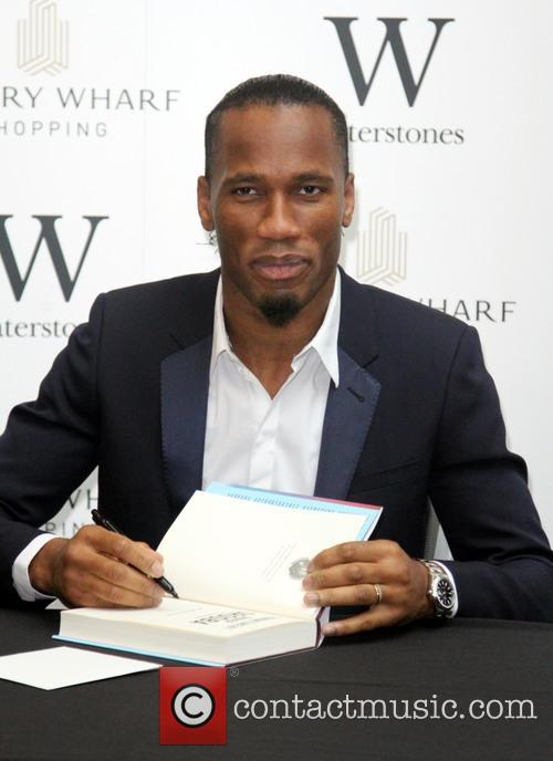 Didier Drogba signs copies of his autobiography 'Commitment'