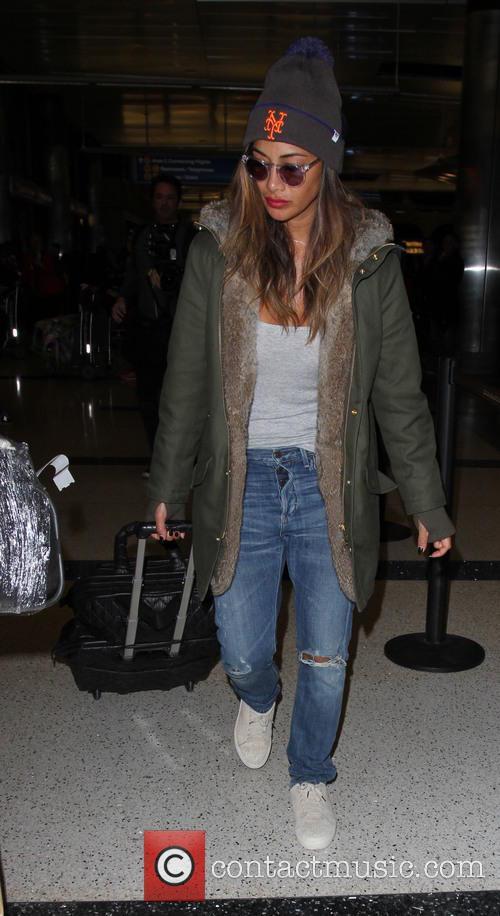 Nicole Scherzinger arrives on a flight to Los...