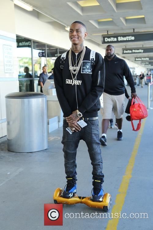 Souljah Boy departs on a flight from Los...