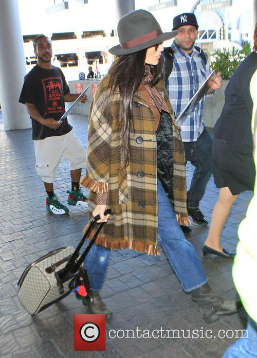 Demi Moore Demi Moore departs on a flight...