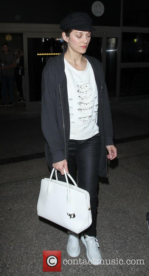 Marion Cotillard arrives on a flight to Los...