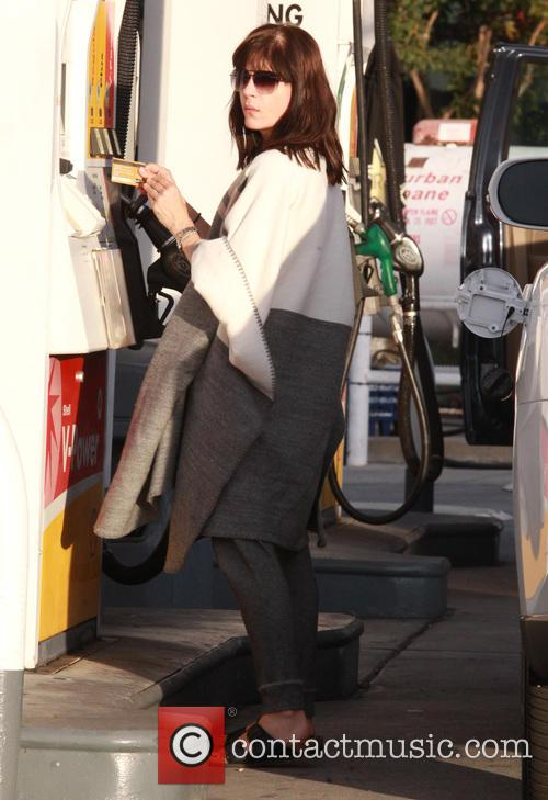 Selma Blair fills her car up with gas...