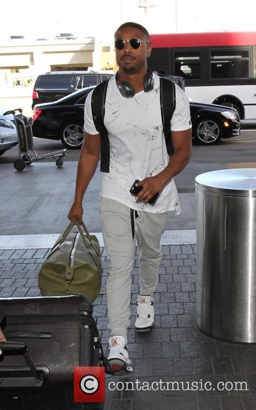 Michael B. Jordan departs on a flight from...