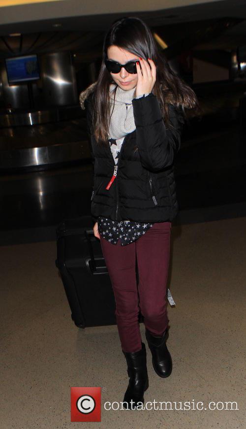 Miranda Cosgrove arrives on a flight to Los...