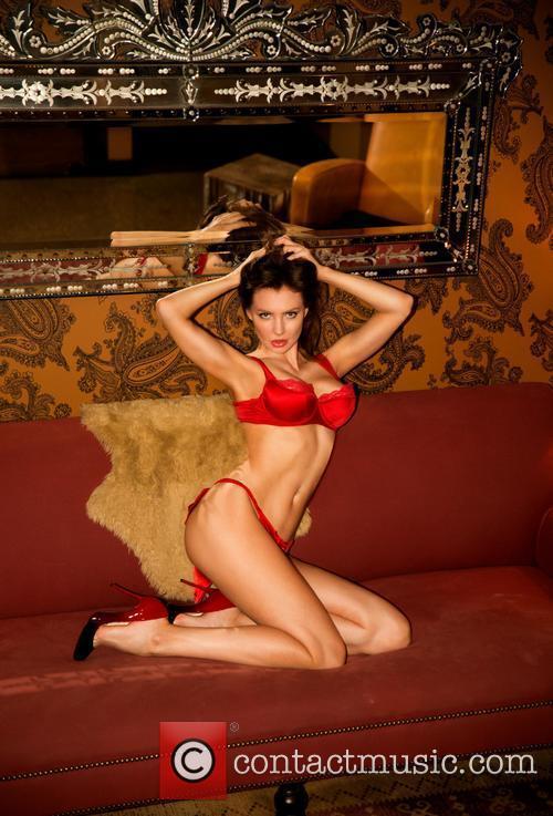 Russian model Yuliya Lasmovich poses for a photoshoot...